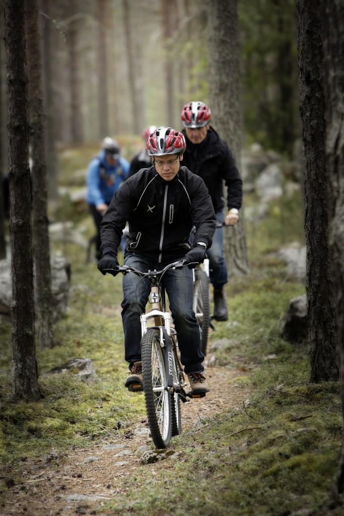Group mountain biking in forest